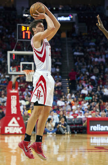 Houston Rockets' Chandler Parsons shoots and scores a 3-point basket during the third quarter of an NBA basketball game against the Golden State Warriors, Tuesday, Feb. 5, 2013, in Houston. The Rockets beat the Warriors 140-109. (AP Photo/Dave Einsel)