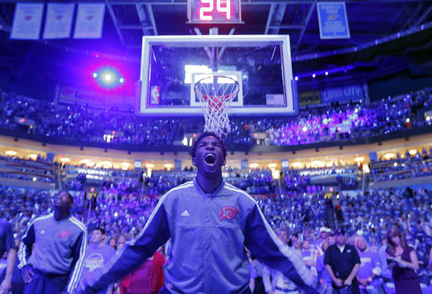 Oklahoma City's Hasheem Thabeet (34) watches the pregame team intro during the second round NBA playoff basketball game between the Oklahoma City Thunder and the Memphis Grizzlies at Chesapeake Energy Arena in Oklahoma City, Sunday, May 5, 2013. Photo by Chris Landsberger, The Oklahoman