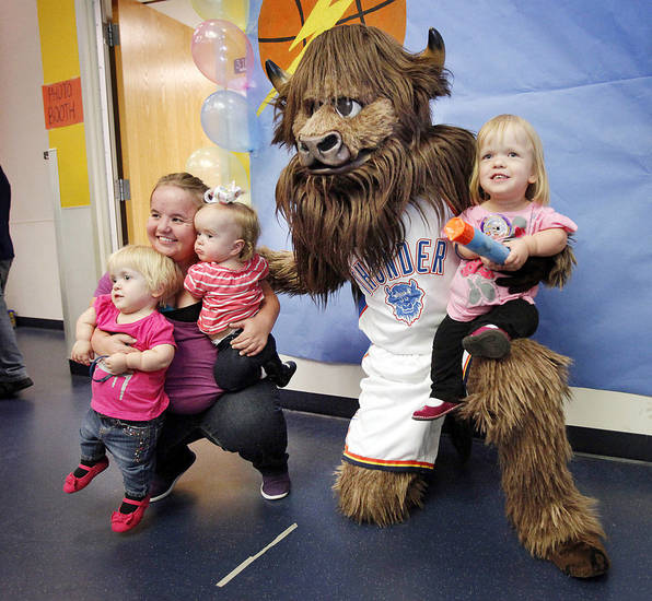 Rumble poses for a photo with, from left, Emily Mahoney, 3, Teri Strickland and her daughter, Evelyn, 1, and Reghan Mahoney, 6, at the J.D. McCarty Center.