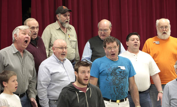 Members of OK Chorale rehearse for an upcoming concert.