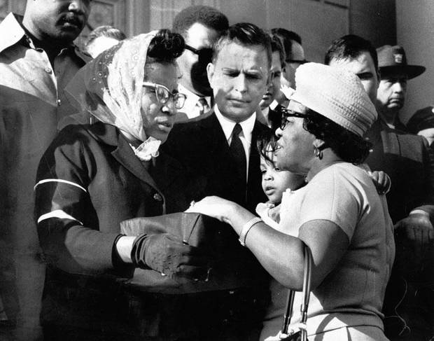 Gov. Dewey Bartlett, center, looks on as NAACP youth council adviser Clara Luper accepts a donation from an unidentified woman. Funds were raised for the NAACP' s Freedom Center as hundreds marched to the state Capitol in memory of the slain Martin Luther King on April 6, 1968. Photo by Robert Taylor, The Daily Oklahoman
