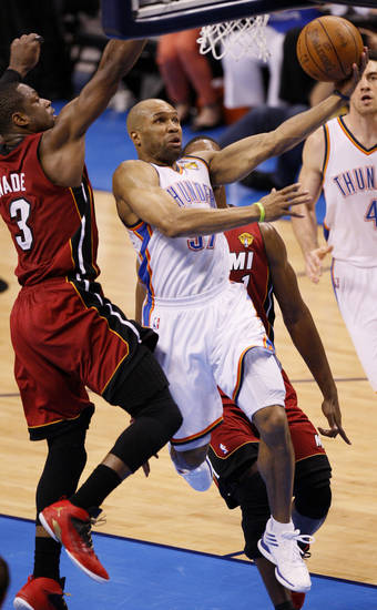Oklahoma City's Derek Fisher (37) goes past Miami's Dwyane Wade (3) during Game 1 of the NBA Finals between the Oklahoma City Thunder and the Miami Heat at Chesapeake Energy Arena in Oklahoma City, Tuesday, June 12, 2012. Photo by Nate Billings, The Oklahoman