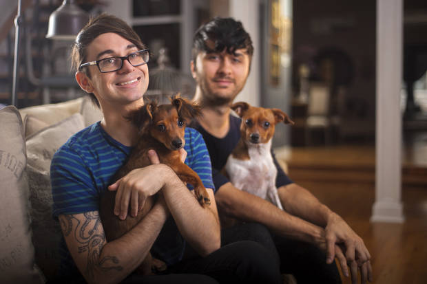 Christian Siriano, left, and Brad Walsh, with Bear and Topper, poses for portrait at their New York City apartment, September 11, 2012. (Karl Merton Ferron/Baltimore Sun/MCT)