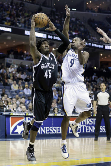 Brooklyn Nets' Gerald Wallace (45) shoots around Memphis Grizzlies' Tony Allen (9) during the first half of an NBA basketball game in Memphis, Tenn., Friday, Jan. 25, 2013. (AP Photo/Danny Johnston)
