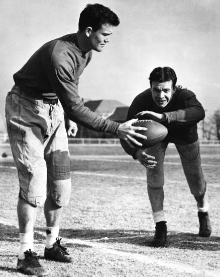 Oklahoma halfback Joe Golding (right) takes a handoff from OU quarterback Darrell Royal during a University of Oklahoma football practice in February 1947. OKLAHOMAN ARCHIVE PHOTO
