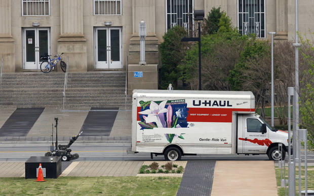 BOMB SCARE: Oklahoma City Police Department bomb robot checks out the rear of a U-Haul truck parked on Walker Avenue across the street from the west entrance to City Hall in downtown Oklahoma City Wednesday, April 17, 2013.  Photo by Paul B. Southerland, The Oklahoman
