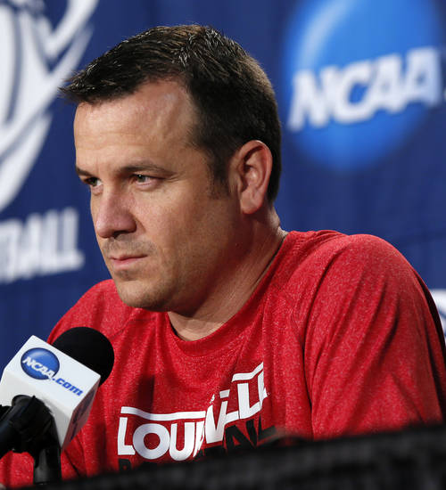 Louisville coach Jeff Walz listens to a question from the media during the press conference and practice day at the Oklahoma City Regional for the NCAA women's college basketball tournament at Chesapeake Energy Arena in Oklahoma City, Saturday, March 30, 2013. Photo by Nate Billings, The Oklahoman
