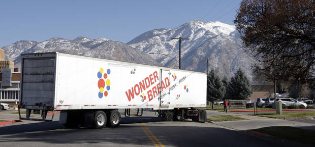 A Hostess Wonder Bread truck is shown in front of the Utah Hostess plant in Ogden, Utah, Thursday, Nov. 15, 2012. Hostess Brands Inc. is warning striking employees that it will move to liquidate the company if plant operations don't return to normal levels by Thursday evening. The maker of Twinkies, Ding Dongs and Wonder Bread said Thursday it will file a motion in U.S. Bankruptcy Court to shutter operations if enough workers don't return by 5 p.m. EST. That would result in the loss of about 18,000 jobs, including hundreds in Ogden. (AP Photo/Rick Bowmer)