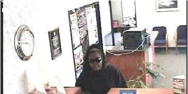 The Bison Federal Credit Union in Shawnee was robbed Monday by this black woman. Photo provided <strong></strong>