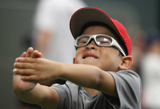 Evan Hamilton, 5, stretches during baseball camp at Moore High School, Friday, June 4, 2010.   Photo by David McDaniel, The Oklahoman