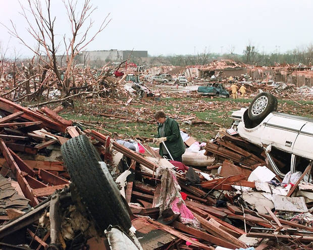 MAY 3, 1999 TORNADO: TORNADO VICTIMS, DAMAGE: A LADY LOOKS THREW THE WRECKAGE OF A HOUSE AS AN APARTMENT COMPLEX IS FLATTENED IN THE BACKGROUND AND BEYOND THAT IS WESTMOORE HIGH. A TORNADO WENT THREW MOORE, OK MONDAY EVENING OFF OF WESTERN AND 12TH STREET.