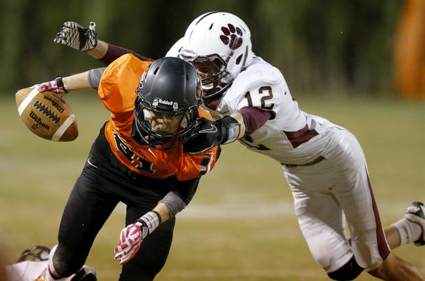 Crescent's Tristan Lacey tries to get past Cashion's Nate Lee during a high school football game between Cashion and Crescent in Crescent, Okla., Thursday, Oct. 18, 2012. Photo by Bryan Terry, The Oklahoman
