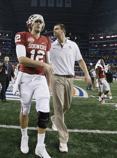 Oklahoma's Landry Jones (12) walks off the field after the 41-13 loss to Texas A&M during the college football Cotton Bowl game between the University of Oklahoma Sooners (OU) and Texas A&M University Aggies (TXAM) at Cowboy's Stadium on Friday Jan. 4, 2013, in Arlington, Tx. Photo by Chris Landsberger, The Oklahoman