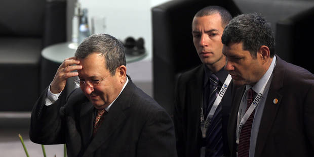 Ehud Barak, Defence Minister of Israel, left, arrivesat the International Security Conference in Munich, southern Germany, Saturday, Feb. 2, 2013. The  Munich Security Conference started Friday afternoon with experts from 90 delegations including U.S. Vice President Joe Biden. (AP Photo/Matthias Schrader)