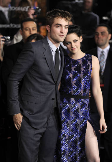 "Robert Pattinson, left, and Kristen Stewart arrive at the world premiere of ""The Twilight Saga: Breaking Dawn - Part 1"" on Monday, Nov. 14, 2011, in Los Angeles. (AP Photo/Chris Pizzello) ORG XMIT: CASH175"