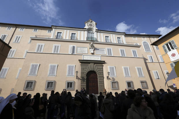 Faithful gather in front of Pope's summer residence of Castel Gandolfo, the scenic town where Pope Benedict XVI will spend his first post-Vatican days and make his last public blessing as pope,Thursday, Feb. 28, 2013. (AP Photo/Luca Bruno)