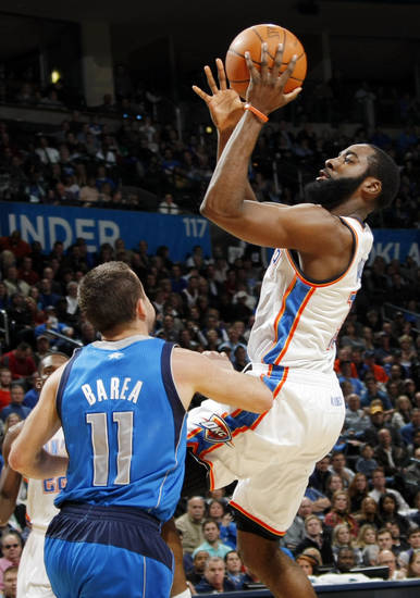Oklahoma City's James Harden (13) shoots over Jose Barea (11) during the NBA basketball game between the Dallas Mavericks and the Oklahoma City Thunder at the Oklahoma City Arena in Oklahoma City, Monday, Dec. 27, 2010. Dallas won, 103-93. Photo by Nate Billings, The Oklahoman