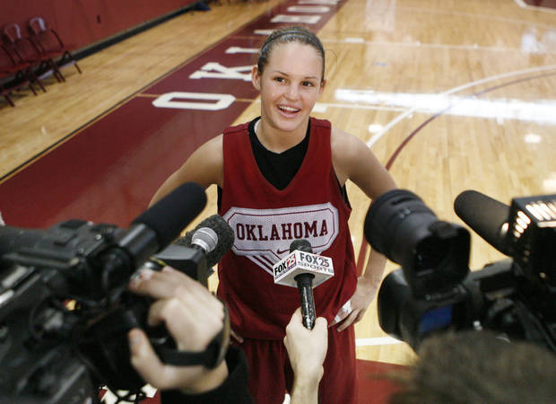 OU's Whitney Hand speaks to reporters in 2009 as the Sooners prepared to leave for the Final Four of the NCAA Tournament. PHOTO BY PAUL HELLSTERN, The Oklahoman Archives