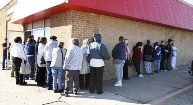 Seniors wait for to receivie a free Thanksgiving dinner at the Salvation Army Social Services office in Oklahoma City. <strong>PAUL HELLSTERN - THE OKLAHOMAN</strong>