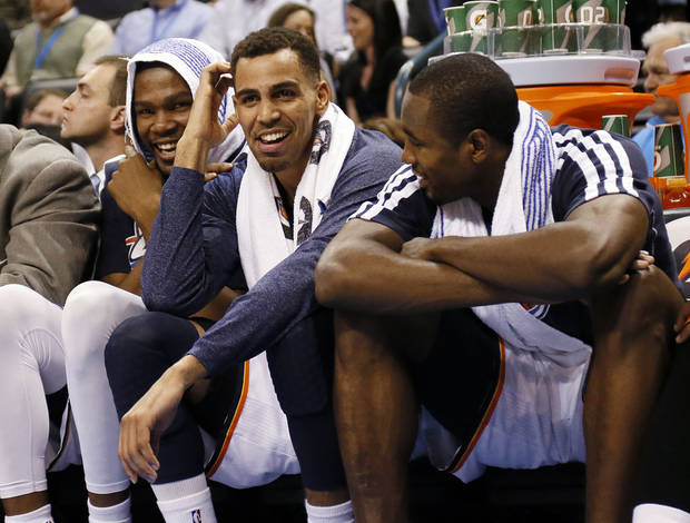 From left, Oklahoma City's Kevin Durant (35), Thabo Sefolosha (2) and Serge Ibaka (9) share a laugh on the bench in the fourth quarter during an NBA basketball game between the Oklahoma City Thunder and the Dallas Mavericks at Chesapeake Energy Arena in Oklahoma City, Monday, Feb. 4, 2013. The Thunder won. 112-91. Photo by Nate Billings, The Oklahoman