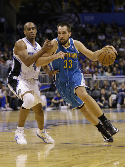 New Orleans Hornets power forward Ryan Anderson (33) drives around Orlando Magic's Arron Afflalo, left, during the first half of an NBA basketball game on Wednesday, Dec. 26, 2012, in Orlando, Fla. (AP Photo/John Raoux)