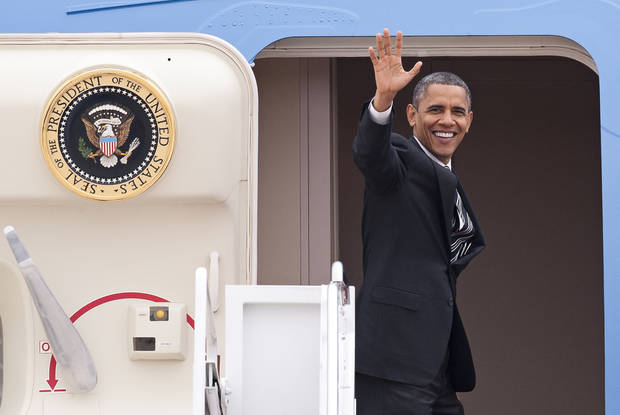 <p>President Barack Obama waves as he boards Air Force One at Andrews Air Force Base, Md., Thursday, Nov. 15, 2012, en route to New York to visit areas devastated by Superstorm Sandy. (AP Photo/Cliff Owen)</p>