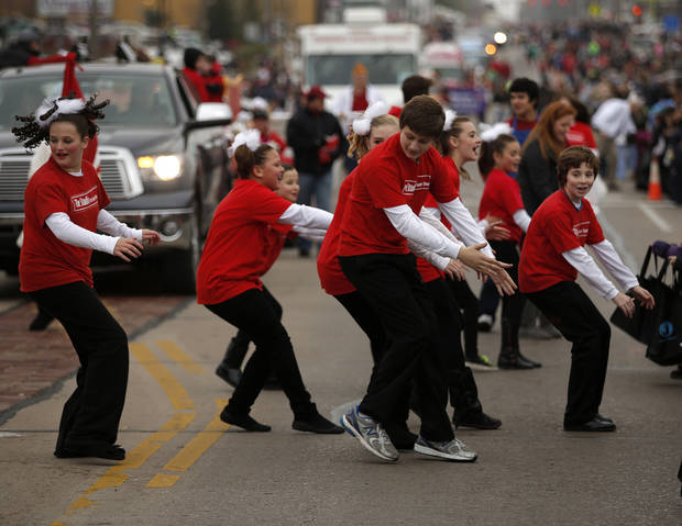 Members of The Studio at Sooner Theatre dance in the Holiday Christmas Parade Saturday in downtown Norman. PHOTO BY GARETT FISBECK, FOR THE OKLAHOMAN <strong>GARETT FISBECK</strong>