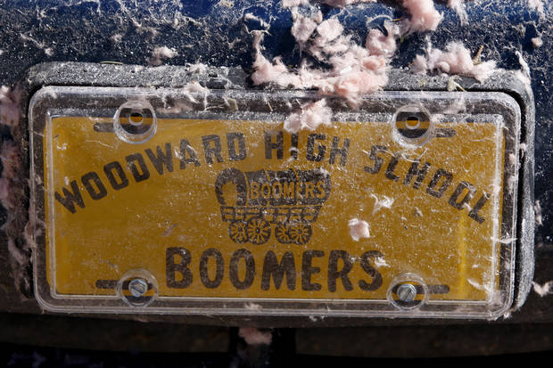 A car tag is covered in debris in Woodward, Okla., Sunday, April 15, 2012. A tornado that killed five people struck Woodward, Okla., shortly after midnight on Sunday, April15, 2012.  Photo by Bryan Terry, The Oklahoman