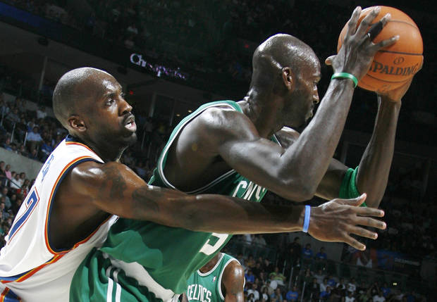 Boston's Kevin Garnett keeps the ball away from Oklahoma City's Johan Petro in the second half during the NBA basketball game between the Oklahoma City Thunder and the Boston Celtics at the Ford Center in Oklahoma City, Wednesday, Nov. 5, 2008. Boston won, 96-83. BY NATE BILLINGS, THE OKLAHOMAN