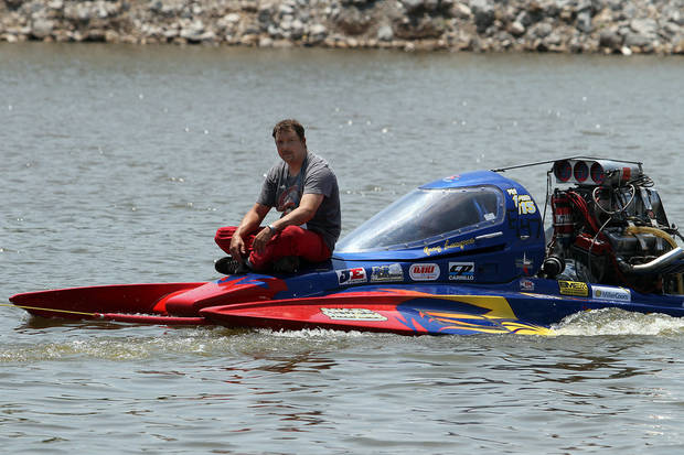 Greg Lempar sits on his boat as he is towed back to the pits during the Oklahoma City Nationals Drag Boat races on the Oklahoma River Saturday, June 9th, 2012. PHOTO BY HUGH SCOTT, FOR THE OKLAHOMAN    ORG XMIT: KOD