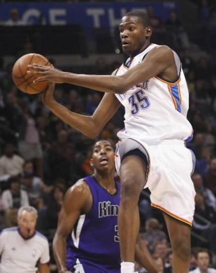 Oklahoma City Thunder guard  Kevin  Durant, right, moves past Sacramento Kings forward Jason Thompson, left, in the third quarter of an NBA basketball game in Oklahoma City, Sunday, Feb. 8, 2009. Oklahoma City won the game 116-113. (AP Photo/Sue Ogrocki)