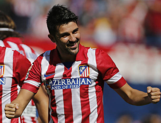 Atletico de Madrid's David Villa celebrates after scoring against Almeria during a Spanish La Liga soccer match at the Vicente Calderon stadium in Madrid, Saturday Sept. 14, 2013. (AP Photo/Paul White)