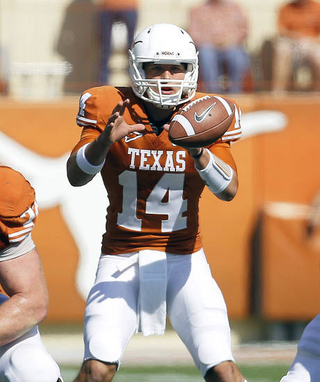 David Ash will have competition for the Texas quarterback job with Case McCoy.  AP ARCHIVE PHOTO