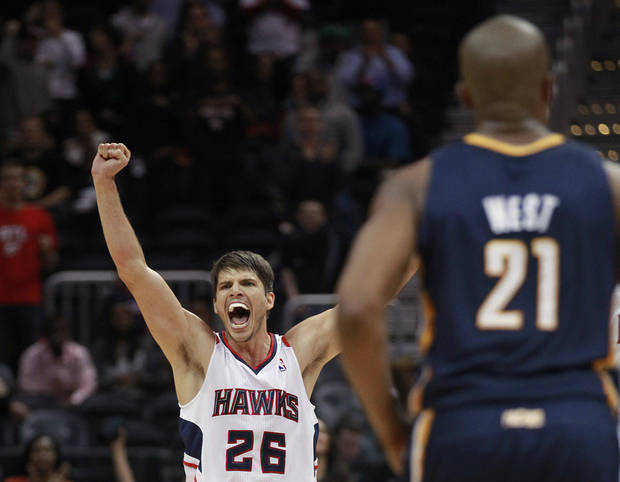Atlanta Hawks' Kyle Korver (26) yells after the Hawks took the lead in the final seconds of an NBA basketball game against the Indiana Pacers on Wednesday, Nov. 7, 2012, in Atlanta. Atlanta won 89-86. (AP Photo/John Bazemore)
