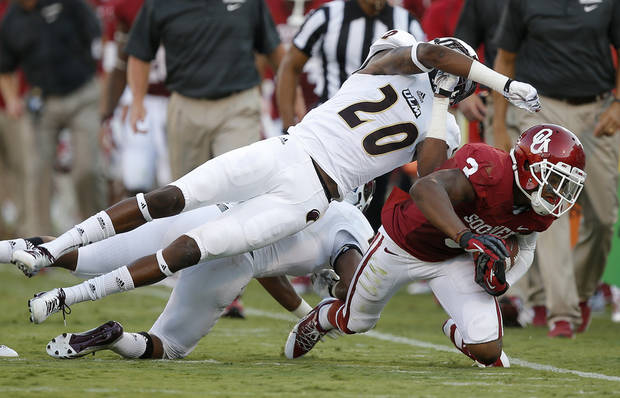 Oklahoma's Sterling Shepard (3) is brought down by Justin Backus (20) during a college football game between the University of Oklahoma Sooners (OU) and the University of Louisiana Monroe Warhawks at Gaylord Family-Oklahoma Memorial Stadium in Norman, Okla., on Saturday, Aug. 31, 2013. Photo by Bryan Terry The Oklahoman