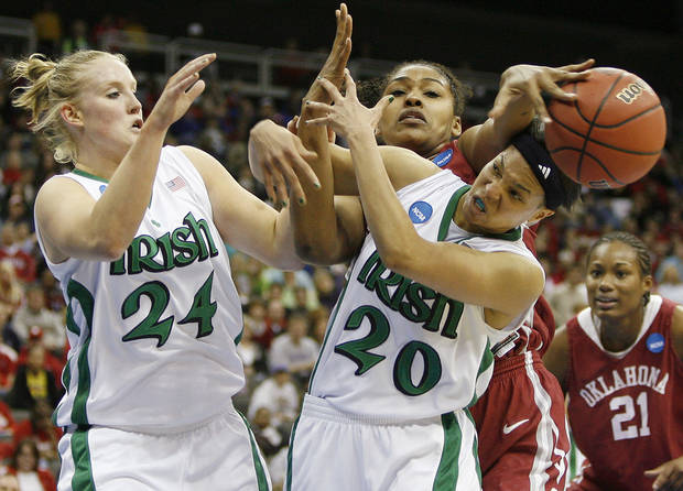 OU&#039;s Abi Olajuwon fights for the ball between Notre Dame&#039;s Lindsay Schrader, left, and Ashley Barlow during the Sweet 16 round of the NCAA women&#039;s  basketball tournament in Kansas City, Mo., on Sunday, March 28, 2010. 