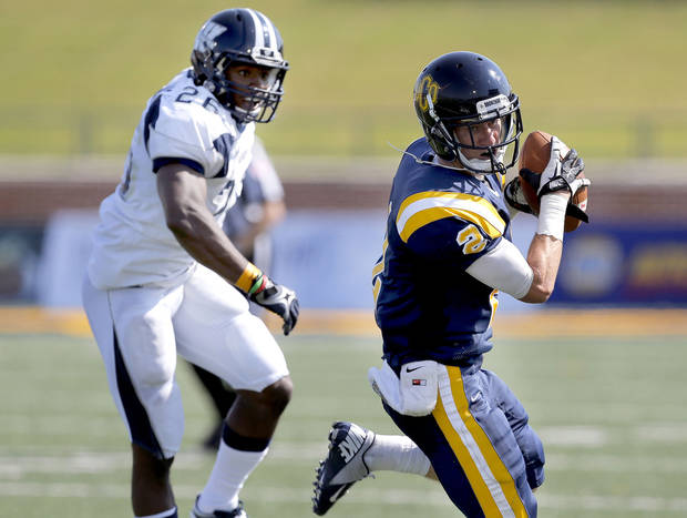 UCO's Christian Hood makes a catch in front of Washburn's Willie Williams during the college football game between the University of Central Oklahoma and Washburn at Wantland Stadium in Edmond, Okla., Saturday, Sept. 22, 2012.  Photo by Sarah Phipps, The Oklahoman