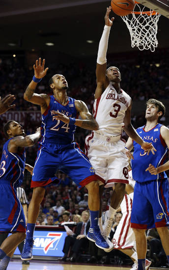 Oklahoma's Buddy Hield (3) shoots guarded by Kansas' Travis Releford (24) during the second half as the University of Oklahoma Sooners (OU) defeat the Kansas Jayhawks (KU) 72-66 in NCAA, men's college basketball at The Lloyd Noble Center on Saturday, Feb. 9, 2013 in Norman, Okla. Photo by Steve Sisney, The Oklahoman