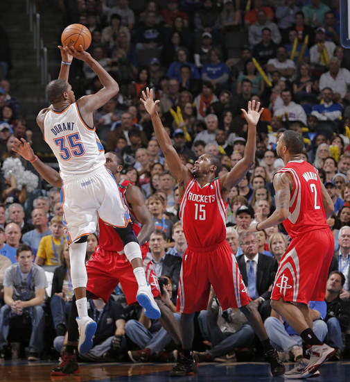 Oklahoma City 's Kevin Durant (35) shoots over Houston's Toney Douglas (15) during the NBA basketball game between the Houston Rockets and the Oklahoma City Thunder at the Chesapeake Energy Arena on Wednesday, Nov. 28, 2012, in Oklahoma City, Okla.   Photo by Chris Landsberger, The Oklahoman