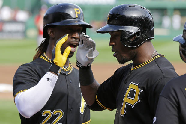 Pittsburgh Pirates' Starling Marte, right, is greeted by Andrew McCutchen after hitting a two-run home run in the third inning off Washington Nationals starting pitcher Stephen Strasburg (37) during a baseball game at Pittsburgh Saturday, May 4, 2013. (AP Photo/Gene J. Puskar)