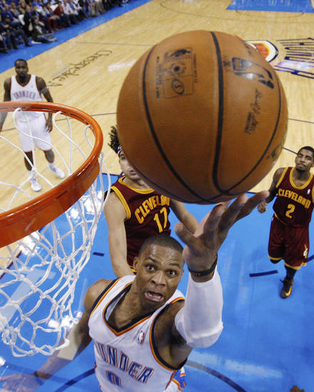 Oklahoma City Thunder guard Russell Westbrook (0) shoots in front of Cleveland Cavaliers center Anderson Varejao (17) in the second quarter of an NBA basketball game in Oklahoma City, Sunday, Nov. 11, 2012. Oklahoma City won 106-91. (AP Photo/Sue Ogrocki)