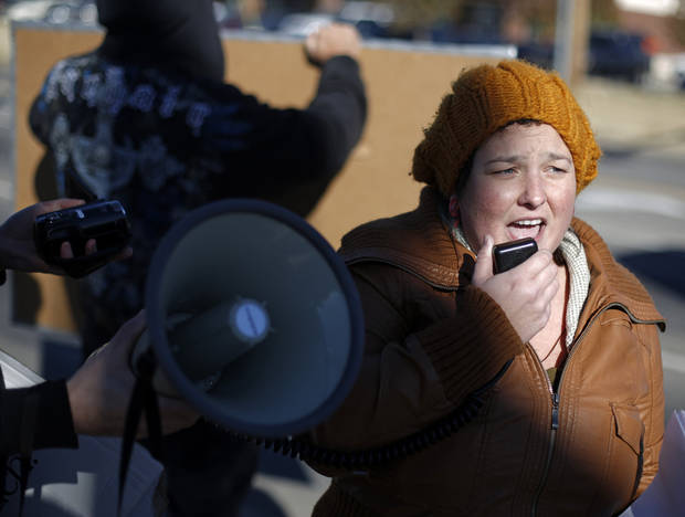 Brittney Guest leads a mic check during an Occupy OKC demonstration at a Wal-Mart in Del City, Friday, Nov. 23, 2012.  Members of the Occupy movement were protesting for Wal-Mart worker's rights to a living wage.  Photo by Garett Fisbeck, The Oklahoman