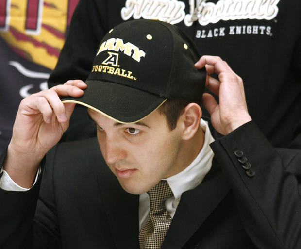 Hunter Frantz puts on an Army hat after signing to play at West Point during a signing ceremony at Putnam City North High School in Oklahoma City Wednesday, Feb. 4, 2009. BY PAUL B. SOUTHERLAND, THE OKLAHOMAN