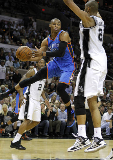 Oklahoma City's Russell Westbrook (0) tries to pass the ball around San Antonio's Tim Duncan (21) during Game 2 of the Western Conference Finals between the Oklahoma City Thunder and the San Antonio Spurs in the NBA playoffs at the AT&T Center in San Antonio, Texas, Tuesday, May 29, 2012. Photo by Bryan Terry, The Oklahoman