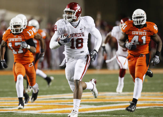 OU tight end Jermaine Gresham takes a catch in for a touchdown against Oklahoma State last season. (Photo by Nate Billings, The Oklahoman)