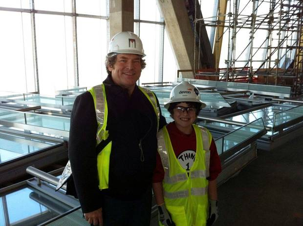 Xander Moore, right, with his grandfather Rick Brown, left, are shown in the top floor of Devon Energy Center during their recent visit. Moore is battling cancer and was given a tour of the 50-story building by Devon executives and contractors. <strong>provided</strong>