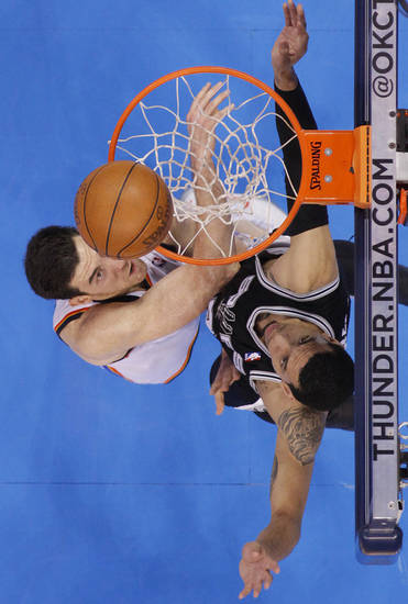 Oklahoma City's Nick Collison (4) battles under the basket with San Antonio's Danny Green (4) during Game 6 of the Western Conference Finals between the Oklahoma City Thunder and the San Antonio Spurs in the NBA playoffs at the Chesapeake Energy Arena in Oklahoma City, Wednesday, June 6, 2012. Photo by Chris Landsberger, The Oklahoman