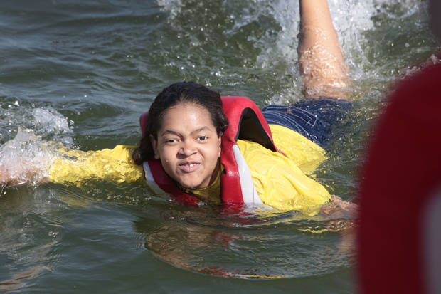 Kacey Guerro-Hawkins, 14, swims after fishing at Camp Cavett at Lake Texoma.  <strong>David McDaniel - The Oklahoman</strong>