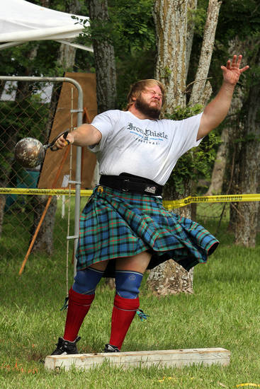 Dave Robinson of Atlanta, Georgia throws the four stone (56 pound) weight during the Iron Thistle Festival in Yukon, Saturday, April 28th, 2012. PHOTO BY HUGH SCOTT, FOR THE OKLAHOMAN  ORG XMIT: KOD