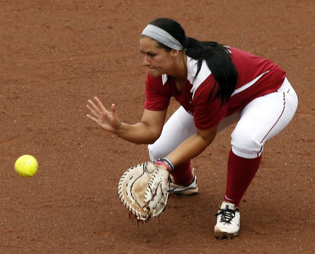 First baseman Lauren Chamberlain makes a catch in the NCAA Super Regional softball game as the University of Oklahoma (OU) Sooners defeat Texas A&M 8-0 at Marita Hines Field on Saturday, May 25, 2013 in Norman, Okla. to advance to the College World Series.  Photo by Steve Sisney, The Oklahoman